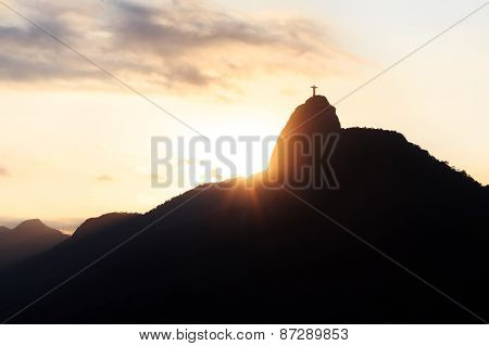 Sun With Rays Behind Mountain Corcovado Christ The Redeemer, Sunset, Rio De Janeiro