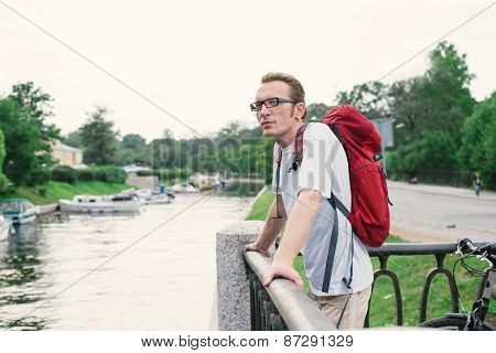 Cyclist Resting On The Embankment