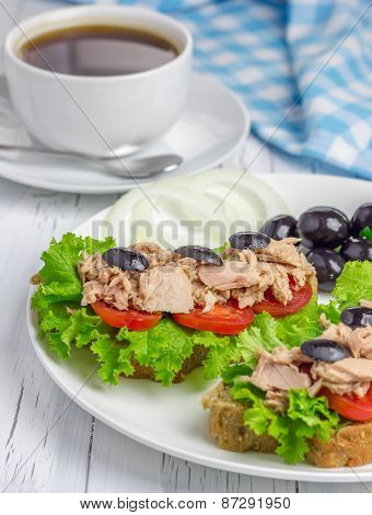 Tuna Fish Sandwiches On The White Plate