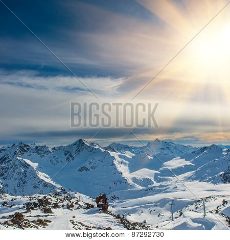 Sunset In Snowy Blue Mountains With Clouds