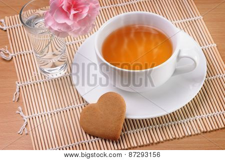 Cup Of Tea With A Heart Shaped Biscuit