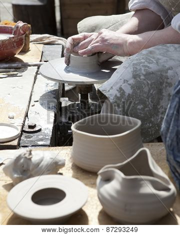 The potter during a jug molding .Close up