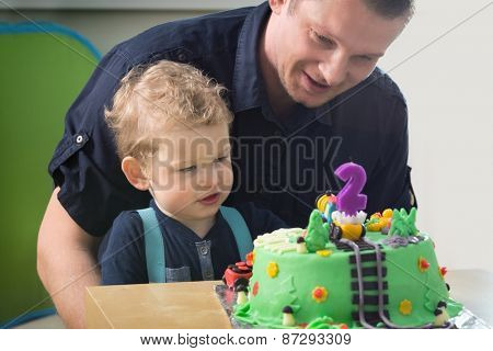 Little boy celebrating his father's second birthday,