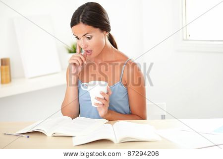 Lovely Woman Looking Surprised While Reading