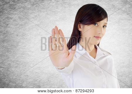 Stop gesture by confident business woman, closeup portrait.