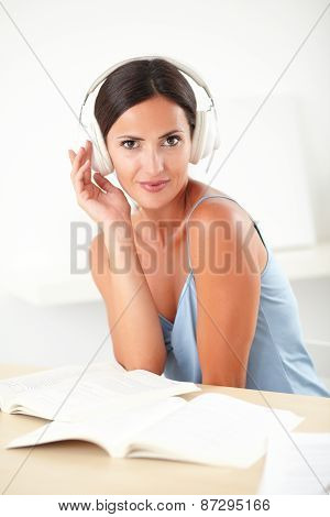 Stylish Woman Sitting And Listening To Music