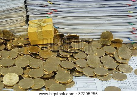 Gift Box In Heap Of Gold Coins