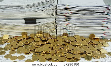 Many Gold Coins In Front Of Documents