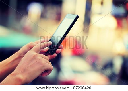 woman hands use smart phone in modern city