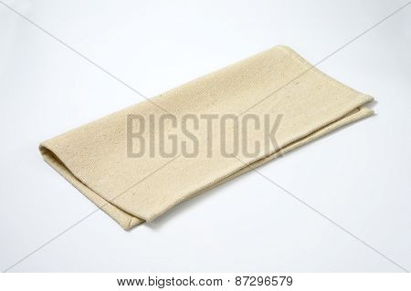 beige place mat on white background
