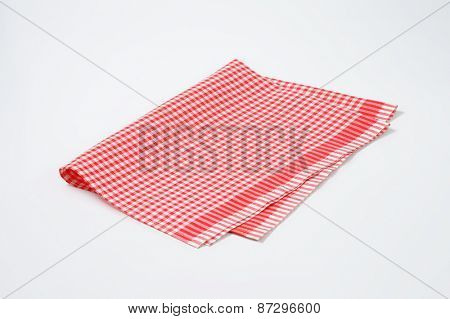 red and white checkered dishtowel on white background