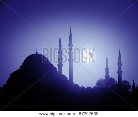 A Night View Of The Majestic Suleiman Mosque In Istanbul With Moon In The Sky.