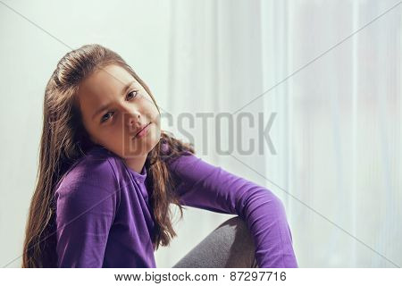Ten year old caucasian girl with long hair posing