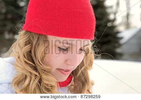 Teenage girl with red knit cap