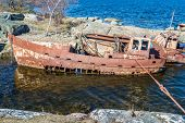 foto of wrecking  - Very rusty and weathered shipwrecks close to shore - JPG