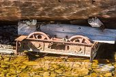 foto of shipwreck  - Old rusty iron wheels from under a shipwreck - JPG