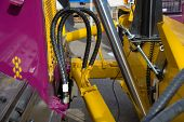 foto of hydraulics  - Hydraulic pressure pipes and piston system of construction machinery - JPG