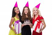 pic of birthday hat  - Photo of happy young women looking at camera - JPG