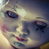 stock photo of scary face  - head of beatiful scary doll like from horror movie  - JPG