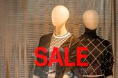 stock photo of hunters  - seasonal sales in a fashion store - JPG