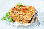 stock photo of lasagna  - Slice of traditional Italian dish lasagna on the plate selective focus  - JPG