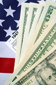 foto of income tax  - USA Tax Day concept with income tax form and cash on stars and stripes flag - JPG