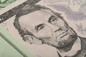 picture of abraham  - Macro of Abraham Lincoln on five USA one dollar banknote - JPG