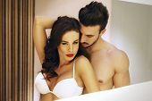 stock photo of lovers  - Sexy passionate couple in mirror milf with young lover - JPG