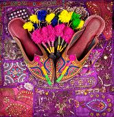 foto of flea  - Colorful ethnic shoes and camel decorations on violet Rajasthan cushion cover on flea market in India - JPG