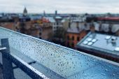 pic of partition  - The roofs of the city from the top of the glass partition with raindrops and the horizon - JPG