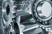 stock photo of titanium  - aerospace cogwheels and bearings in titanium and steel - JPG