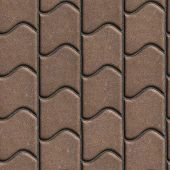 stock photo of paving  - Brown Paving Slabs of the Wavy Form - JPG