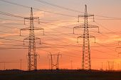 image of power transmission lines  - Electric power transmission lines at sunset outskirts of St - JPG
