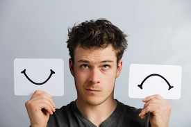 picture of sign-boards  - Portrait of a Questioning Man Holding Happy and Unhappy Survey Mood Board - JPG