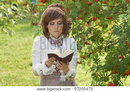 Girl Leafs Through The Book