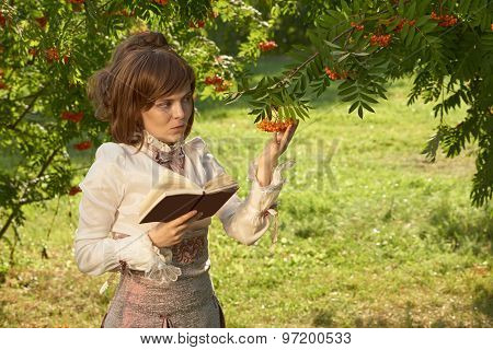 Girl Holds Rowan Berries