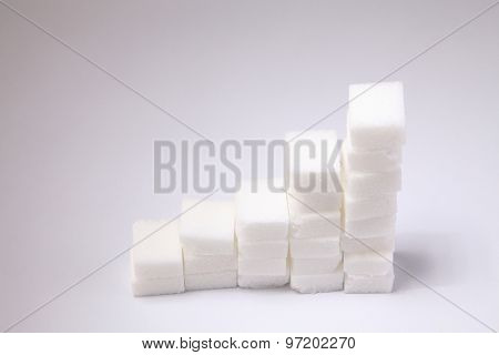 Ascending stacks of sugar cubes - high blood sugar risk concept