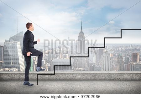 Businessman walking with his leg up against cityscape