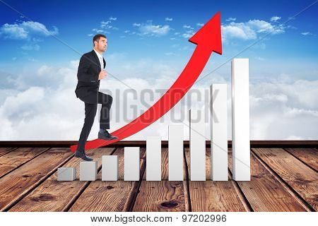 Businessman walking with his leg up against wooden planks against blue sky