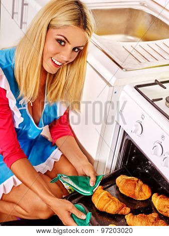 Young woman bake cookies. Kitchen.