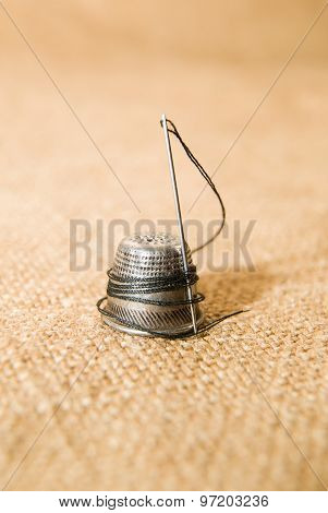 Needle And Thimble On The Old Cloth