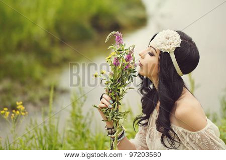Boho Girl Sniffing Bouquet Of Wildflowers.