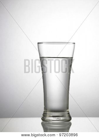 glass of water on top of glass table