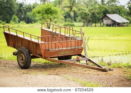 Old car trailer on the rice field ,Thailand.