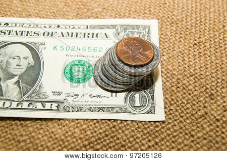 Us Dollars Banknote And Coins On An Old Cloth