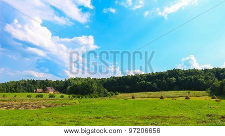 house, haystack, in the field, carpathian village, Ukraine