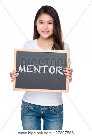 Young woman hold with chalkboard and showing a word mentor