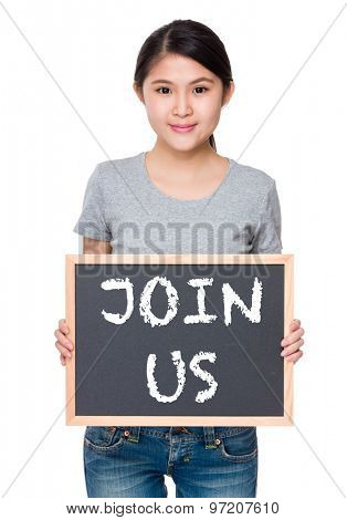 Woman hold with chalkboard and showing phrase join us