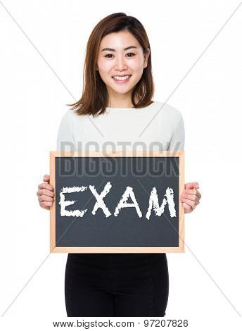 Young woman with the blackboard showing a word exam