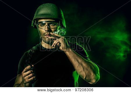 Brave soldier in camouflage and helmet holding a gun. Military.